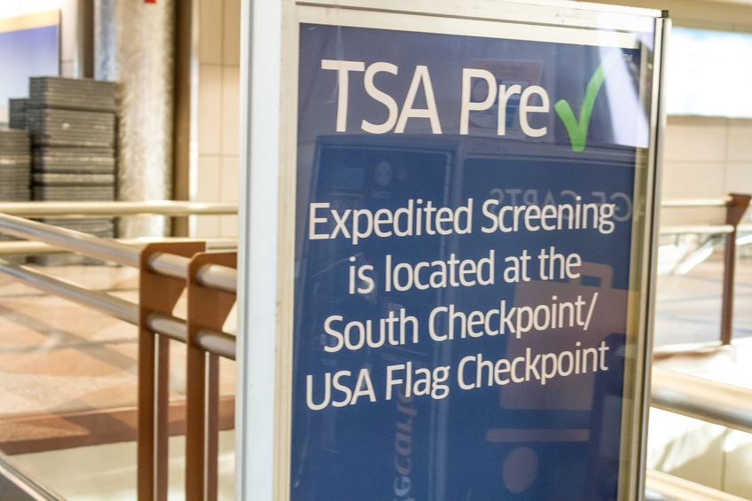 17403478 - tsa pre check in expedited screening sign at airport